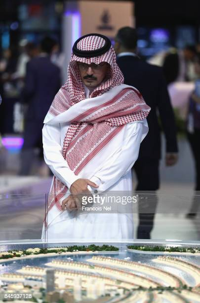 A visitor looks at a scale model of Palm Jumeirah during Cityscape Global at Dubai World Trade Centre on September 12 2017 in Dubai United Arab...
