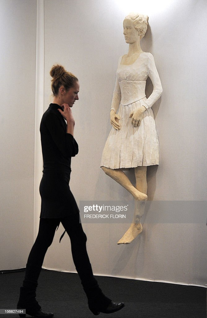 A visitor looks at a sculpture by German artist Evelyn Weinzierl on the opening day of the 'ST-ART' European contemporary art fair on November 22, 2012 in Strasbourg, eastern France. The event takes place between November 23 and November 26, 2012.