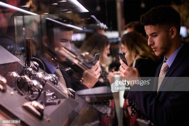 A visitor looks at a selection of Patek Philippe watches at the BaselWorld watch fair on March 22 2018 in Basel Switzerland The annual watch trade...