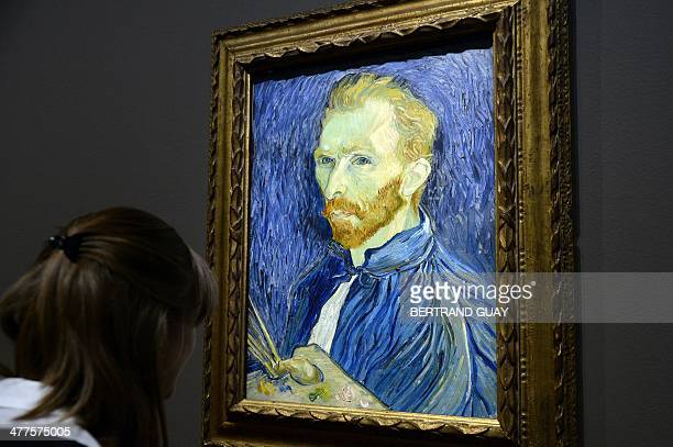 A visitor looks at a selfportrait by late Dutch painter Vincent Van Gogh displayed at the Orsay Museum as part of the exhibition 'Van Gogh/Artaud The...