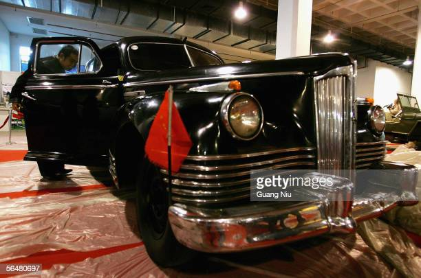 A visitor looks at a Soviet Union made car named 'Gise 110' which served for the late China's chairman Mao Zedong in the 195060's at an auto show on...