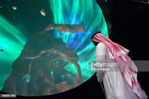 A visitor looks at a spherical monitor at the Gitex 2017 exhibition at the Dubai World Trade Center in Dubai on October 8 2017 / AFP PHOTO / GIUSEPPE...