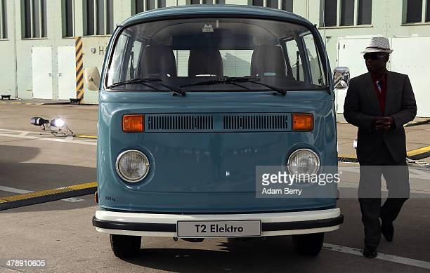 Visitor looks at a Volkswagen T2 Elektro van at the Electric Mobility Week , a public Volkswagen event at the former Tempelhof airport, on March 15,...