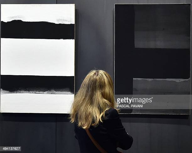 A visitor looks at a work by French painter engraver and sculptor Pierre Soulages at the museum of the « Outrenoir » master on May 28 2014 in the...
