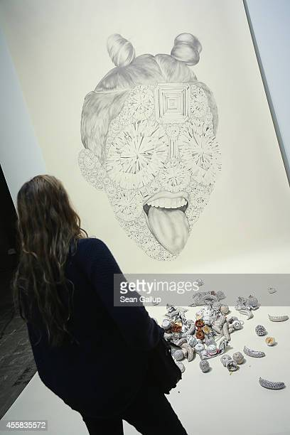 """Visitor looks at a work by Luciana Rondolini at the """"art berlin contemporary"""" art trade fair at The Station on September 20, 2014 in Berlin, Germany...."""