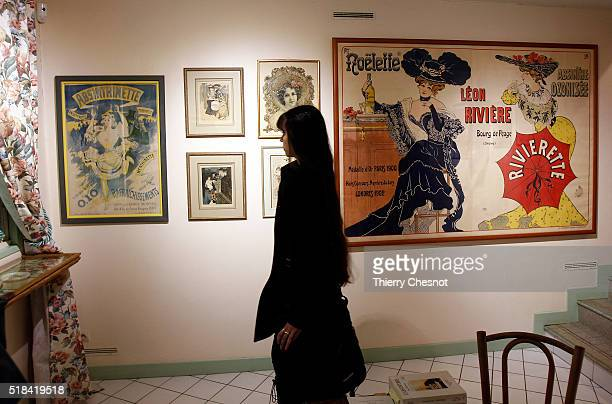 A visitor looks at an advertising for the Absinthe in the absinthe museum on March 31 2016 in AuverssurOise France Absinthe was the favorite drink of...