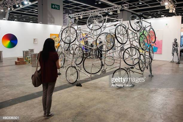 A visitor looks at an art installation at Art Basel Exhibition on May 14 2014 at the Hong Kong Convention and Exhibition Centre in Wan Chai Hong Kong...