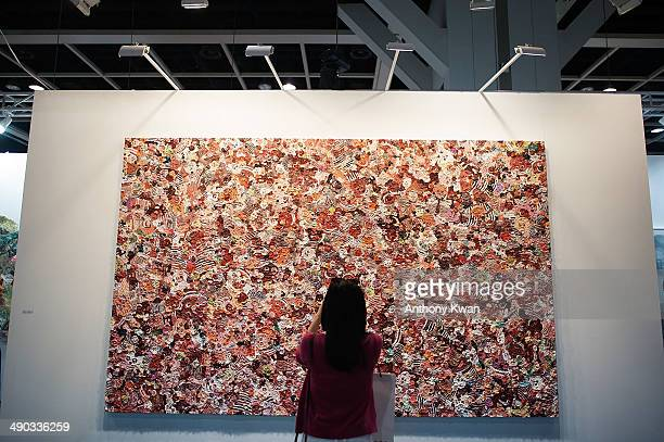A visitor looks at an art installation at Art Basel on May 14 2014 at the Hong Kong Convention and Exhibition Centre in Wan Chai Hong Kong VIP and...