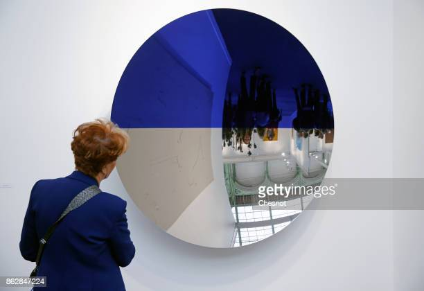 A visitor looks at an artwork by indian artist Anish Kapoor at the Grand Palais as part of the FIAC international contemporary art fair on October 18...