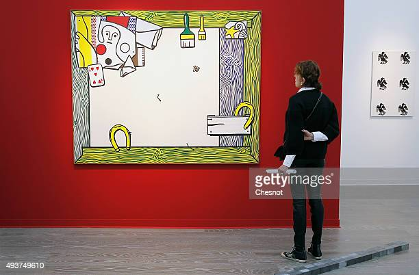 A visitor looks at an artwork entitled 'Things on the wall' by US artist Roy Lichtenstein at the Grand Palais as part of the FIAC international...