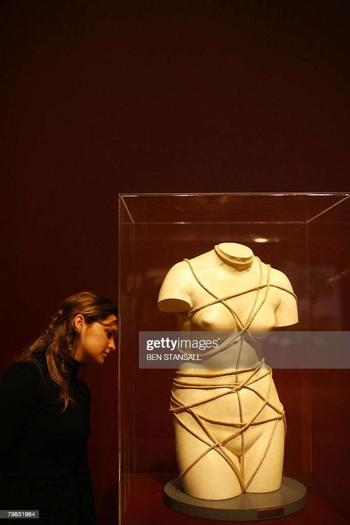 A visitor looks at an artwork entitled 'Venus restauree' (1936) by artist Man Ray at the opening of the Duchamp, Man Ray, Picabia exhibition at the Tate Modern in London, on February 19, 2008.