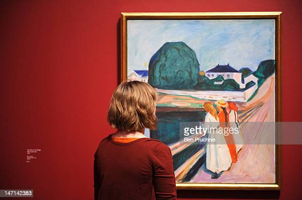 A visitor looks at an exhibition of work by Norwegian artist Edvard Munch at Tate Modern on June 26 2012 in London England