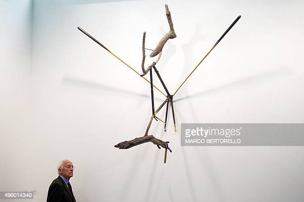 A visitor looks at an installation by Spanish artist Jorge Peris during the 'Artissima' art fair at Oval Lingotto on November 6 2015 in Turin The art...