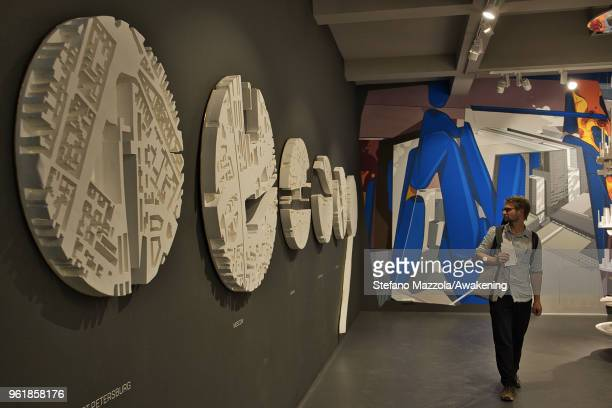 A visitor looks at an installation in the Russian pavilion at the 16th International Architecture Biennale on May 23 2018 in Venice Italy