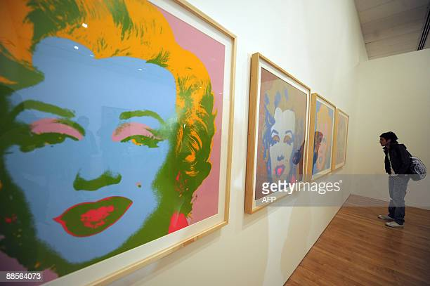 A visitor looks at Andy Warhol's paintings from the serie 'Marilyn Monroe 1969' in Bogota on June 18 in Bogota The Art Museum of the Republic Bank in...
