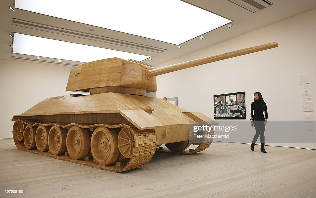 A visitor looks at artist Amy Cheung's full size wooden 'Toy Tank' at the 'Hong Kong Eye' exhibition at Saatchi Gallery on December 4, 2012 in London, England. The Hong Kong Eye Presented by Prudential is the first major international showcase of contemporary art from the city anywhere in the world and runs from December 5, 2012 to January 12, 2013.