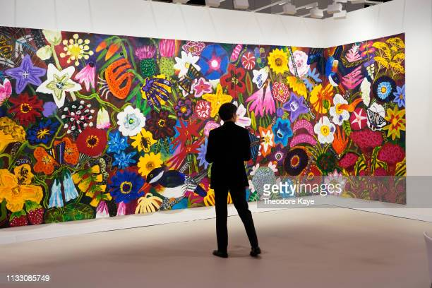 Visitor looks at artwork at Art Basel on March 27, 2019 in Hong Kong, Hong Kong. Art Basel Hong Kong 2019 will be open to public from March 29 to...
