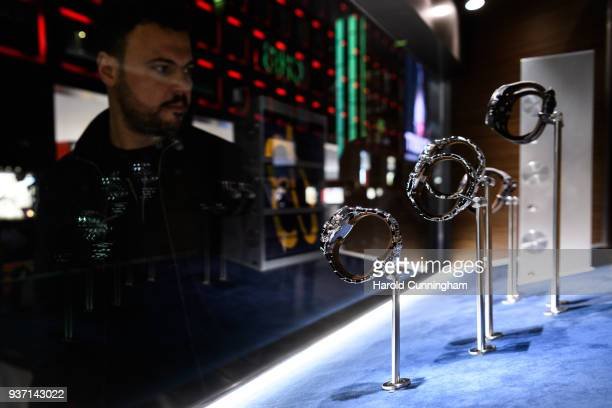 A visitor looks at Breitling watches during the BaselWolrd watch fair on March 23 2018 in Basel Switzerland The annual watch trade fair sees the very...