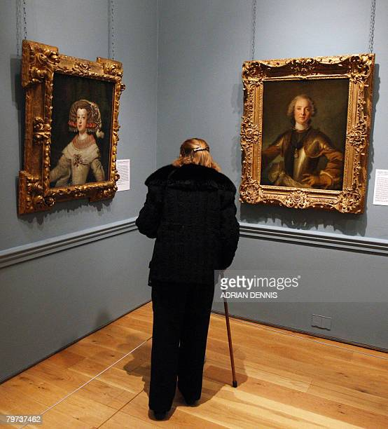 A visitor looks at Diego Velazquez's Portrait of the Infanta Maria Theresa of Spain and JeanMarc Nattier's Portrait of a Commander of the Order of...