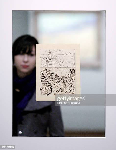 A visitor looks at drawings of Dutch painter Vincent van Gogh during the 'Van Gogh's letters exhibition press preview on October 6 2009 The...