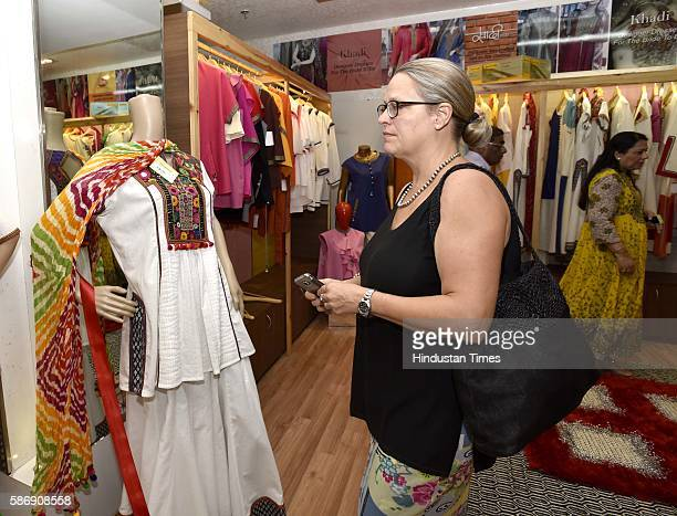 A visitor looks at fashion designer Ritu Beri's Khadi collection inaugurated by Union Minister for Micro Small and Medium Enterprises Kalraj Mishra...