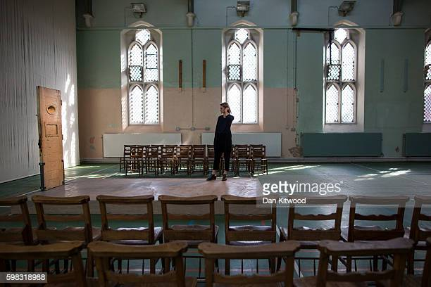 A visitor looks at former inmate Oscar Wilde's prison cell door in the prison Chapel of the former Reading Prison building on September 1 2016 in...
