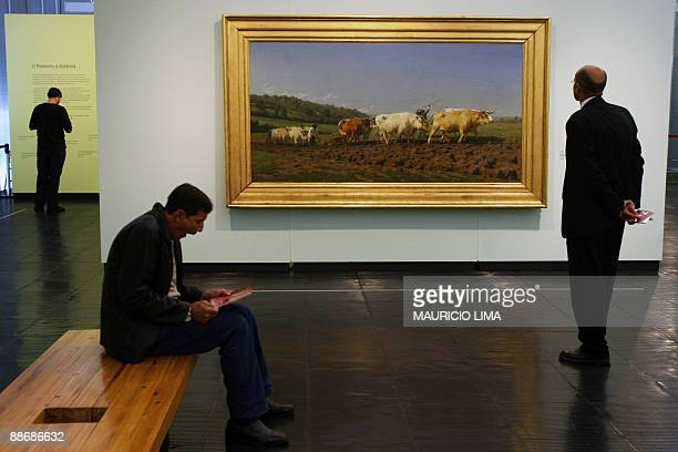 A visitor looks at French artist Rosa Bonheur painting Plowing in Nevers during a retrospective exhibition Art in France1860 to 1960 The Realism as...