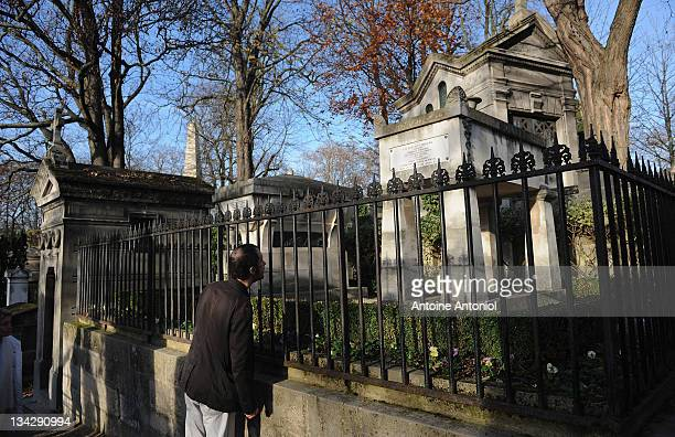 A visitor looks at French writer JeanBaptiste Moliere grave at Cimetierre du Pere Lachaise on November 29 2011 in Paris France