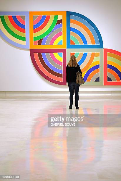 A visitor looks at Haran II by US artist Frank Stella belonging to the Guggenheim foundation as part as an exhibition called Guggenheim Collection...