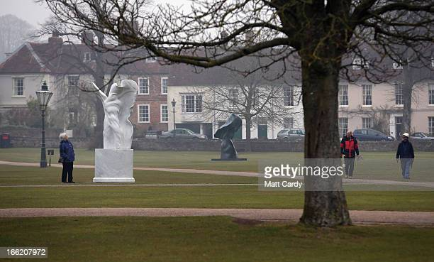 A visitor looks at Helaine Blumenfeld's sculpture 'Mysteries' which has been installed outside Salisbury Cathedral as part of her major new sculpture...