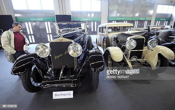A visitor looks at Hispano Suiza displayed at Paris Retromobile show on January 22 2010 The fair takes place from January 22 to January 31 presenting...