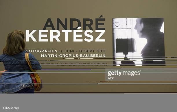 A visitor looks at Hungarianborn US photographer Andre Kertesz' 'Selfportrait 1927' at the Kertesz retrospective at Berlin's MartinGropiusBau June 16...