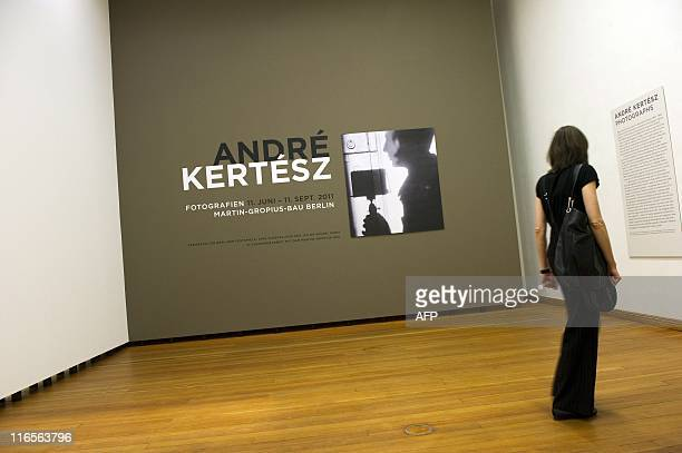 A visitor looks at Hungarianborn US photographer Andre Kertesz' Selfportrait 1927 at the Kertesz retrospective at Berlin's MartinGropiusBau June 16...