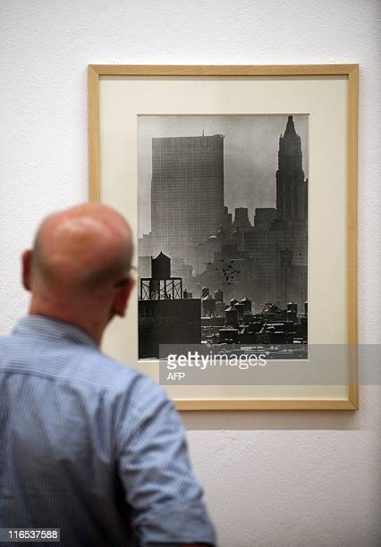 A visitor looks at Hungarianborn US photographer Andre Kertesz' Wall Street Quarter 1963 at the Kertesz retrospective at Berlin's MartinGropiusBau...