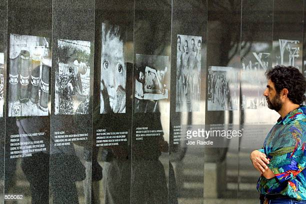 A visitor looks at images from the Holocaust April 29 2001 at the Holocaust Memorial in South Beach FL