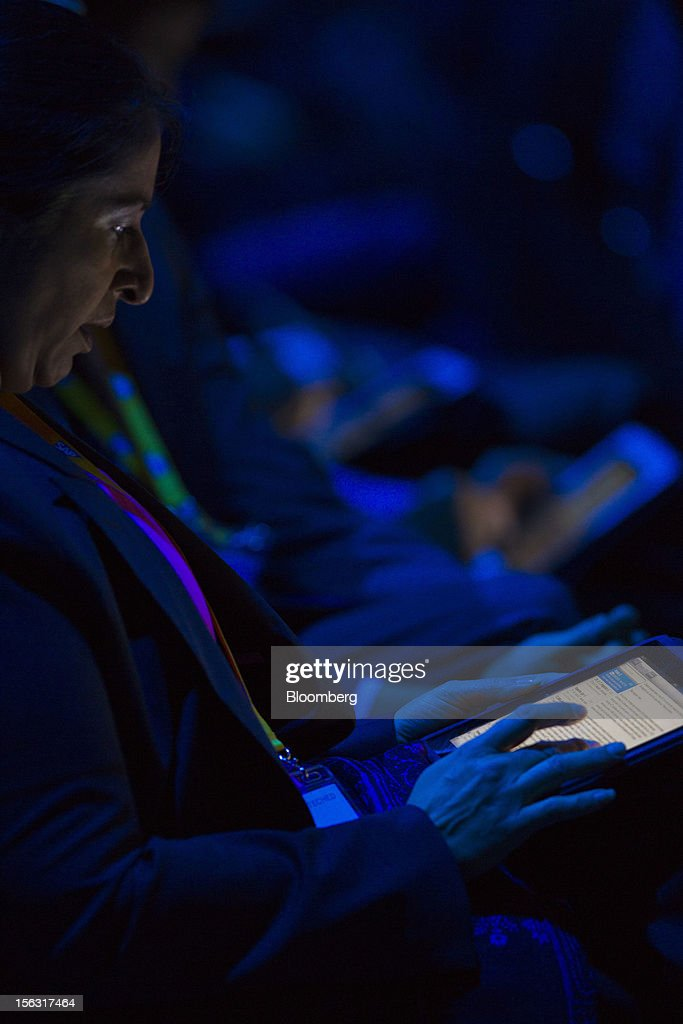 A visitor looks at information on a tablet computer during the keynote address by Jim Hagemann Snabe, co-chief executive officer of SAP AG, on the opening day of the Sapphire Now conference in Madrid, Spain, on Tuesday, Nov. 13, 2012. SAP plans to deliver 6 SAP mobile apps for Windows 8. Photographer: Angel Navarrete/Bloomberg via Getty Images