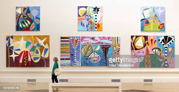 Visitor looks at paintings hanging at The Royal Academy Summer Exhibition on June 9, 2010 in London, England. The RA Summer exhibition is the world's...