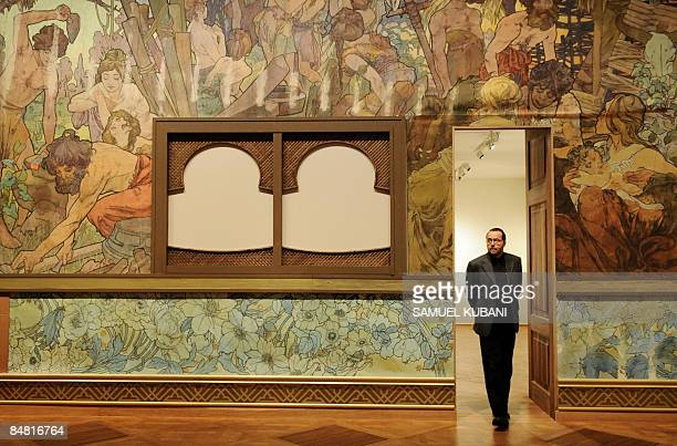 A visitor looks at paintings of Czech Art Nouveau artist Alfons Mucha during the opening of the Alfons Mucha exhibition on February 112009 at the...