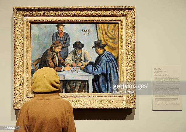 A visitor looks at Paul Cézanne's 189092 The Card Players on February 7 2011 at the Metropolitan Museum of Art in New York during a preview for the...