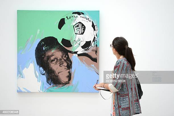 A visitor looks at 'Pele' a 1978 silkscreen by Andy Warhol at the exhibition 'Fútbol The Beautiful Game' May 28 2014 at the Los Angeles County Museum...