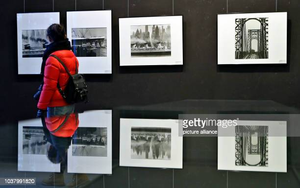 A visitor looks at photographs by Andreas Feininger in the Meisterhaeuser in DessauRosslau Germany 21 February 2013 Photographs by the famous...