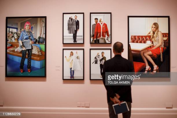Visitor looks at photographs displayed at the Only Human: Photographs by Martin Parr exhibition during the press preview at National Portrait Gallery...
