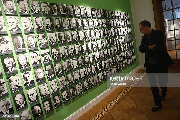A visitor looks at photographs of Germans who resisted the Nazis at the newlyexpanded museum of the German Resistance Memorial Center during its...