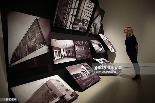 A visitor looks at photographs of the Bauhaus building at Dessau on display at the 'Bauhaus Art as Life' exhibition at The Barbican on May 2 2012 in...