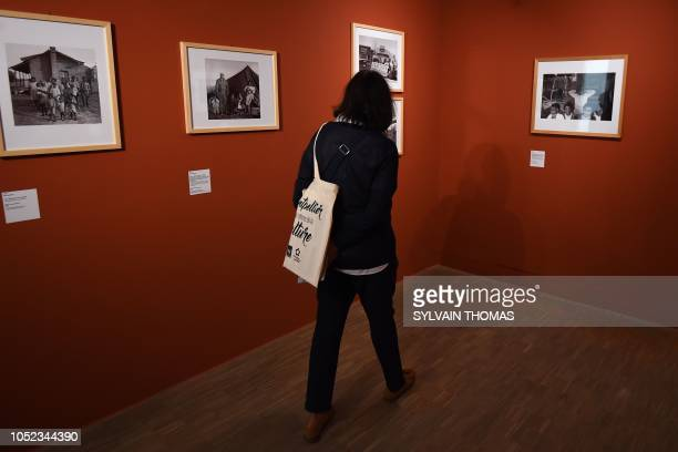 A visitor looks at pictures at the exhibition entitled 'I am a man' Photographs and struggles for civic rights in the south of the USA 19601970 at...