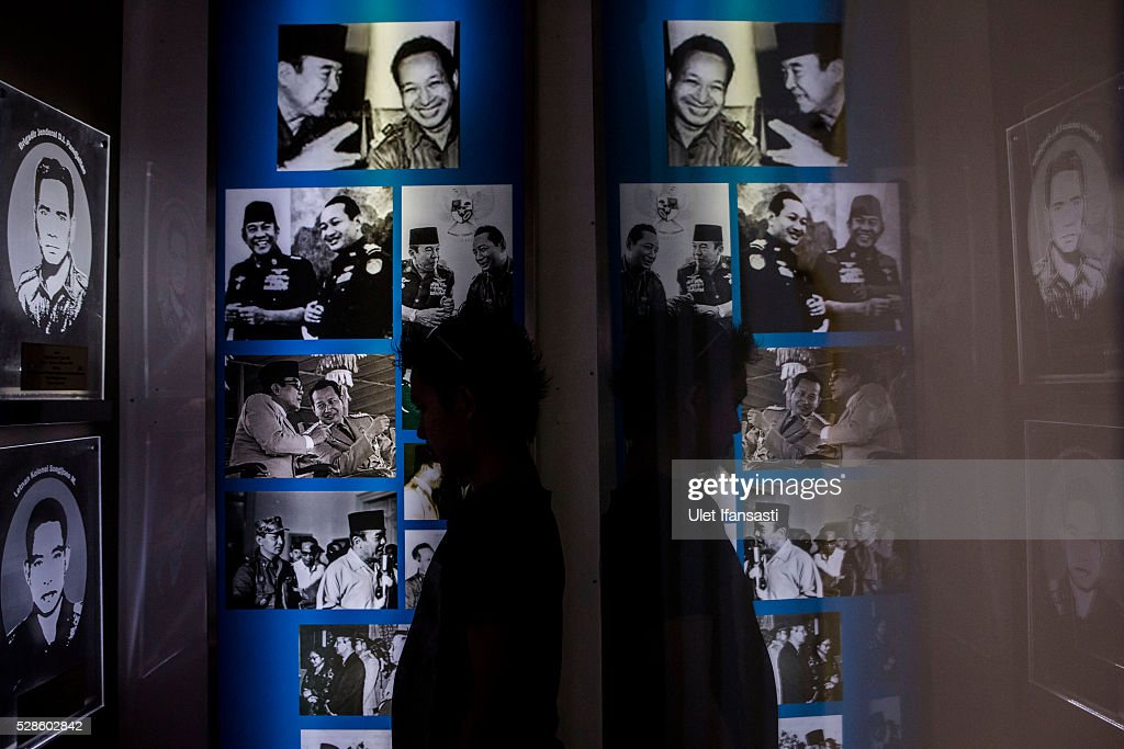 A visitor looks at pictures of Soeharto at Soeharto museum on May 06, 2016 in Yogyakarta, Indonesia. Survivors of Indonesia's anti-communist massacres in 1965 called for investigations on the country's purges, in which hundreds of thousands of people are believed to have been killed by the Indonesian military when the Cold War was escalating in Southeast Asia. Based on human rights groups, half a million people died in 1965 during a massacre carried out by the military and religious groups after an attempted coup by suspected communists, where an officer-led group kidnapped and executed six generals on the night of Septemeber 30, 1965. Known as one of the worst mass atrocities of the 20th century, many among the dead had no connection to Communism, and hundreds of thousands had been held in dentention centers for years during the period.