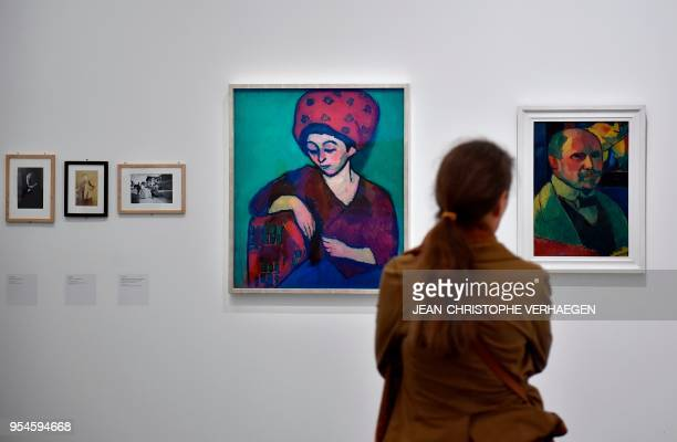 A visitor looks at pieces of art by the couple Alexej Jawlensky and Marianne von Werefkin during the exhibition 'Couples modernes' on May 4 2018 at...
