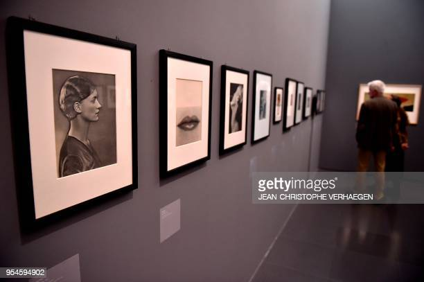 A visitor looks at pieces of art by the couple Man Ray and Lee Miller during the exhibition 'Couples modernes' on May 4 2018 at the Centre...