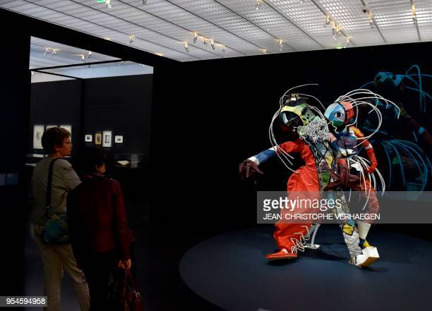 A visitor looks at pieces of art by the couple of artists Walter Holdt and Lavinia Schulz during the exhibition 'Couples modernes' on May 4 2018 at...