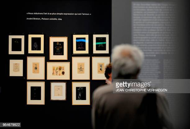 A visitor looks at pieces of art by the couples of artists Andre Breton Nadja Valentine Hugo and Jacqueline Lamba during the exhibition 'Couples...